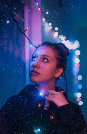 Woman and Christmas Lights: Holiday Blues