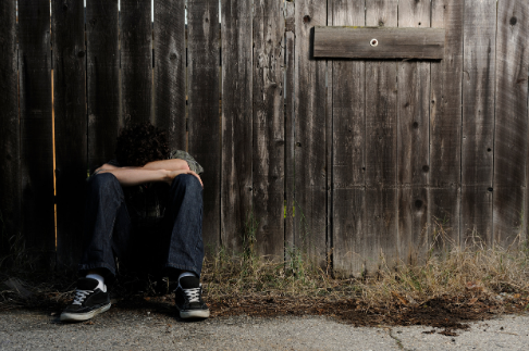 teen sitting depressed lonely suicidal