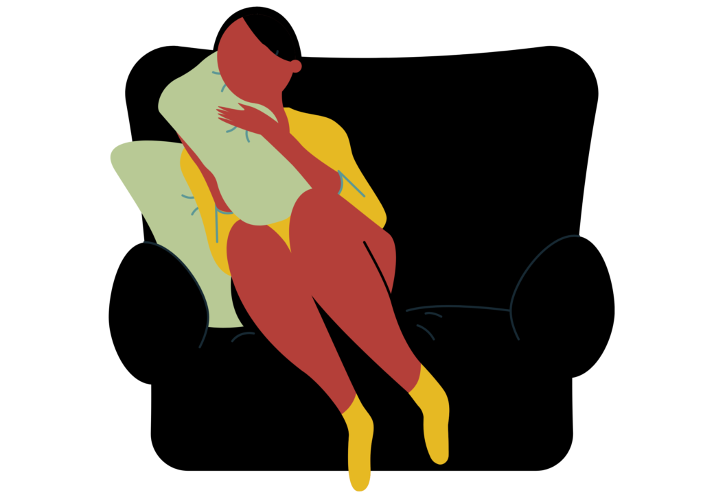 A woman with an injury sits in a chair thinking that she may benefit from counseling for a chronic illness.