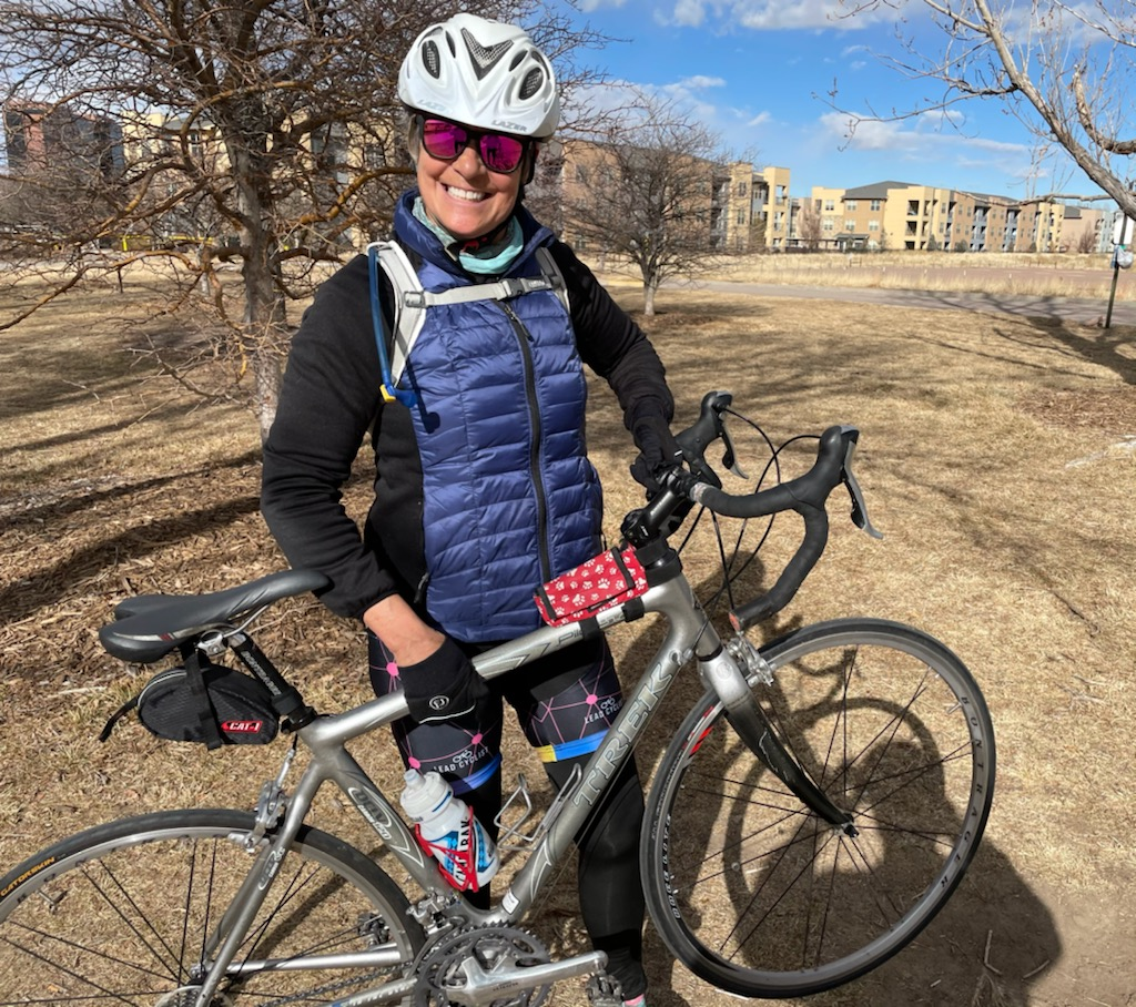 Nancy Bipolar Disorder woman standing smiling with bicycle